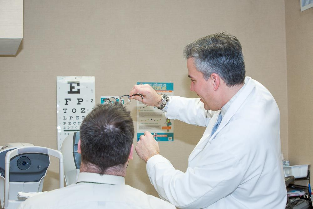 Dr. James Dello Russo performing an eye exam at New Jersey Eye Center Bergenfield