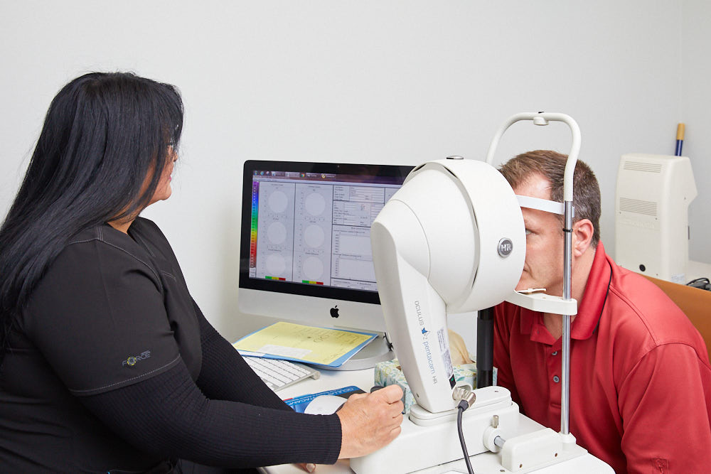Nicole Aquino examining a patient