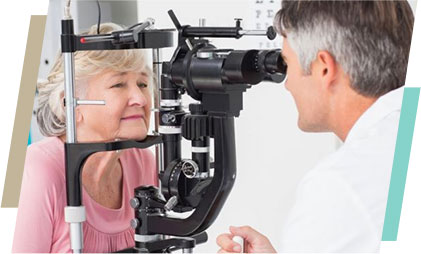 Doctor performing eye exam of an elderly lady