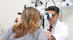 Eye doctor doing eye exam of a patient
