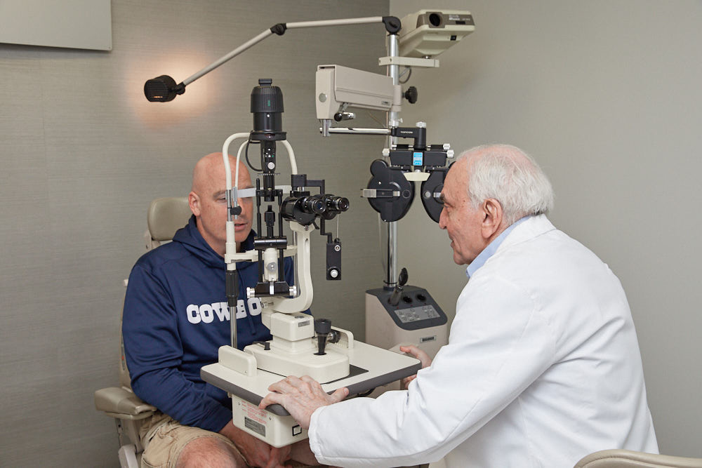 LASIK Sugeon Dr. Joseph Dello Russo doing eye exam of a patient
