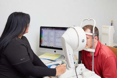 Man going through eye exam to determine if he blinks more